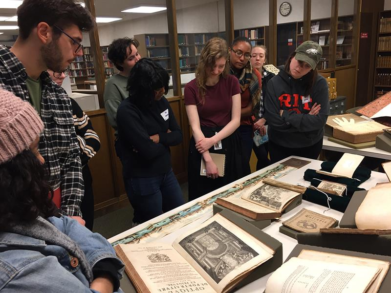 A group of graduates student rare books at Winterthur.