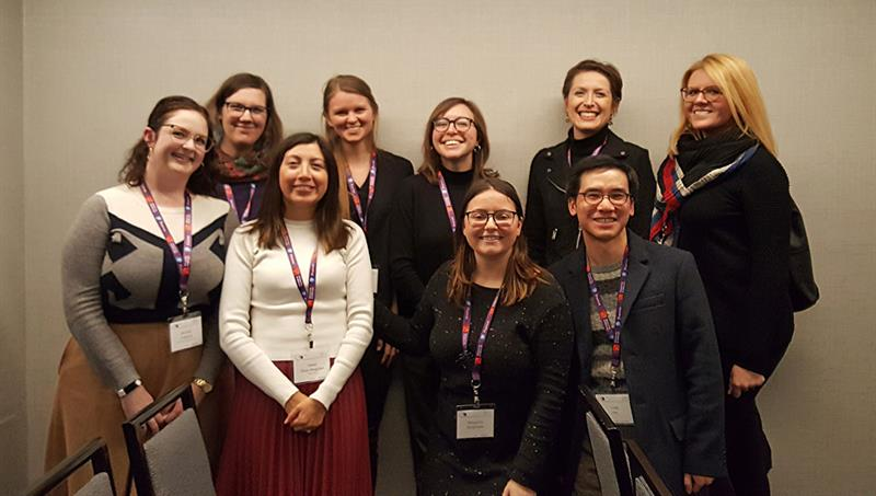 Nine current and former graduate students at the Annual CAA Conference.