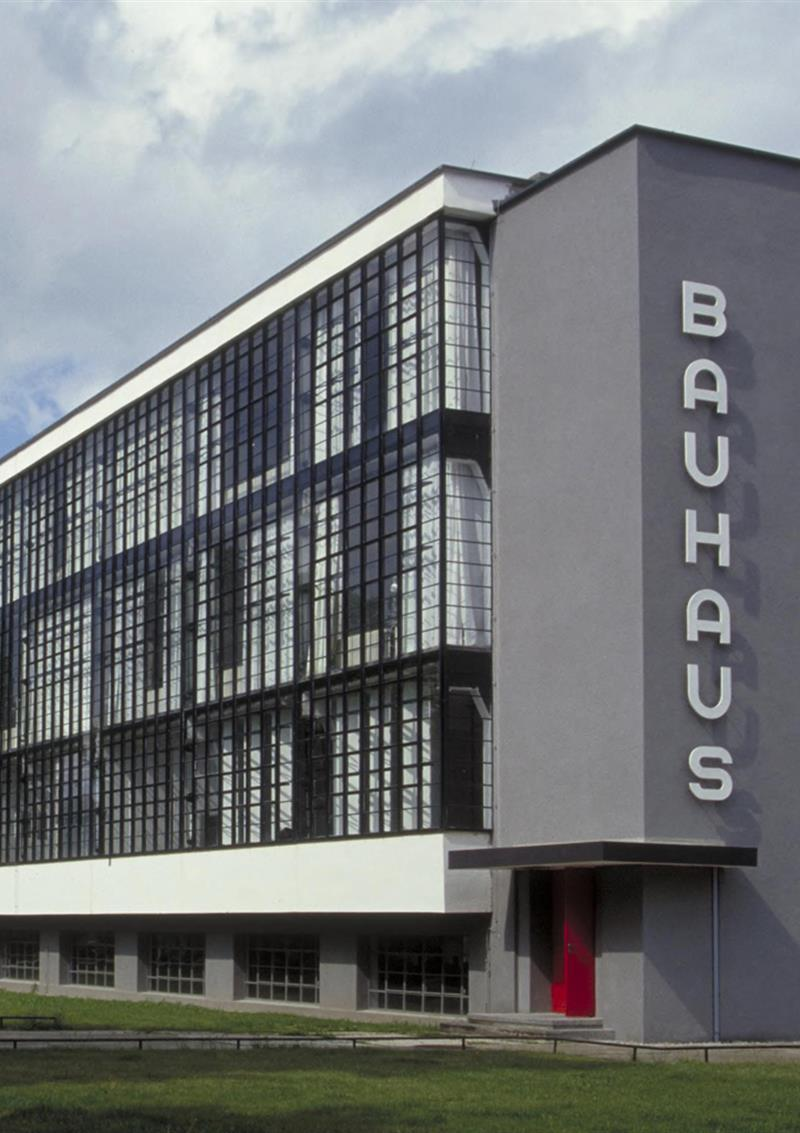 "Exterior view of a modern building with the word ""Bauhaus"" on it"
